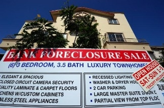 A bank foreclosure sale sign is posted in front of townhomes on August 12, 2010 in Los Angeles, California.
