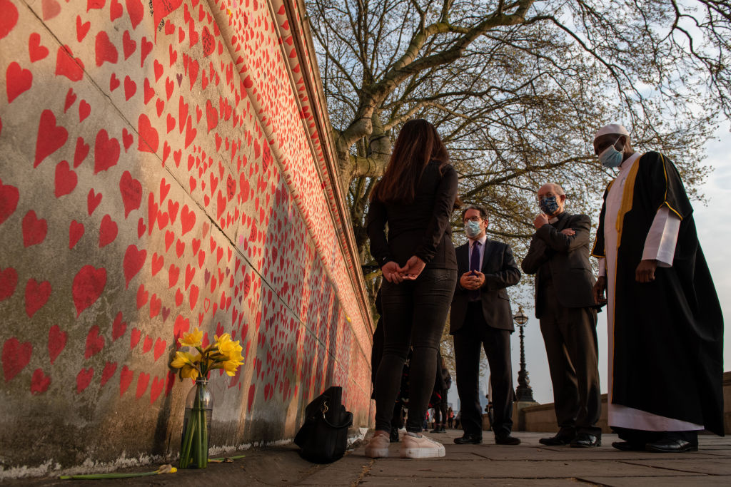 In this handout provided by Covid-19 Bereaved Families For Justice, The Archbishop of Canterbury Justin Welby, Rabbi Daniel Epstein and Imam Kareem Farai visit the National Covid Memorial Wall on April 20, 2021, in London, England.