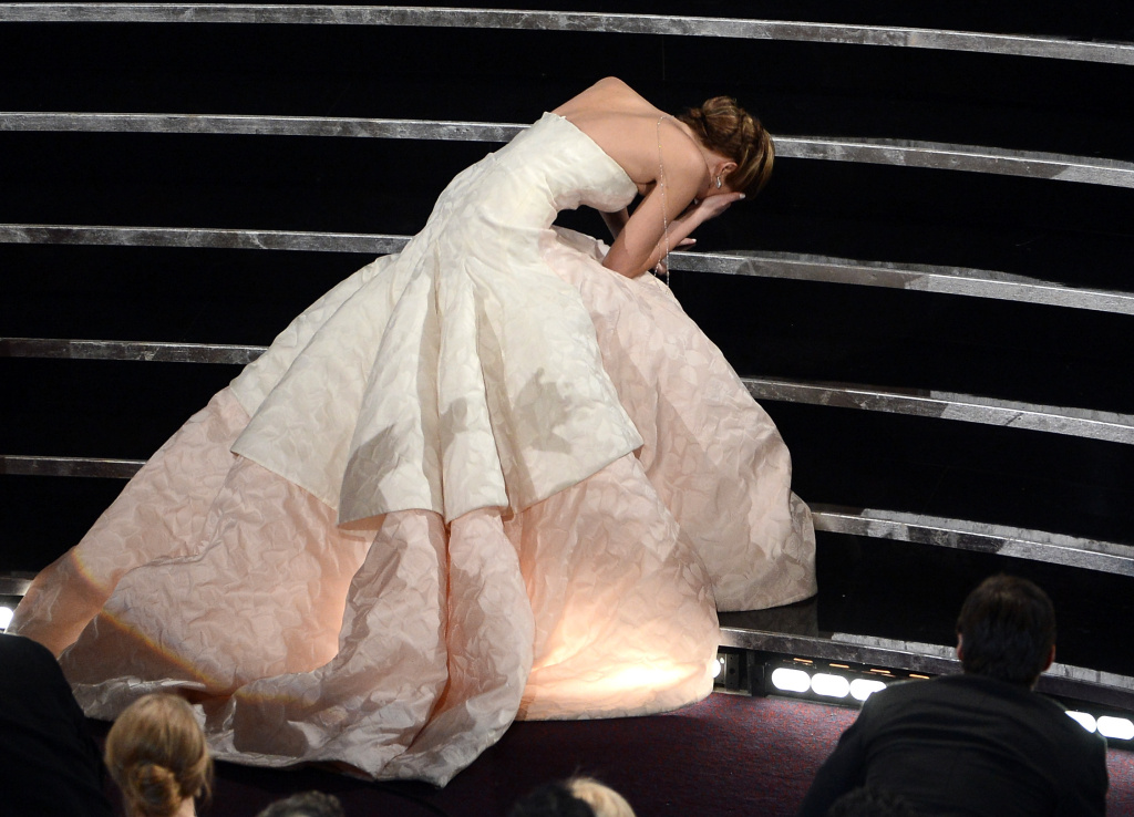 Actress Jennifer Lawrence reacts after winning the Best Actress award for