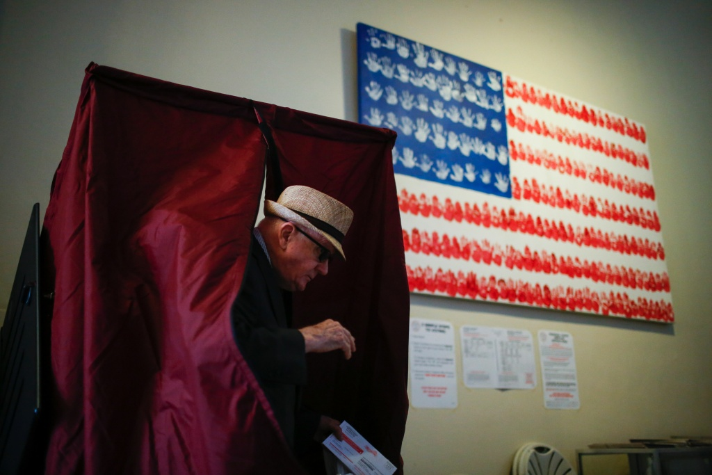 June 7, 2016: A man casts his ballot at a polling station in New Jersey. In California, county voter registration offices are scrambling to make sure polling places will be staffed on Election Day.