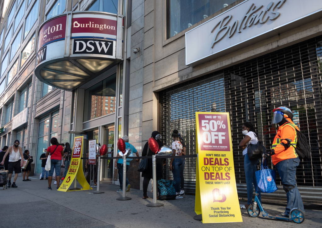 Shoppers line up near sale signs at a Burlington store in New York in June.