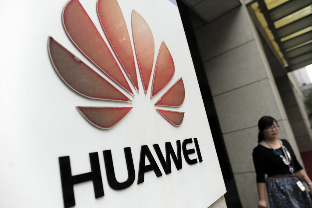 A visitor walks out from the entrance to the Huawei office in Wuhan, central China's Hubei province on October 8, 2012. Beijing on October 8 urged Washington to 'set aside prejudices' after a draft Congressional report said Chinese telecom firms Huawei and ZTE were security threats that should be banned from business in the US.