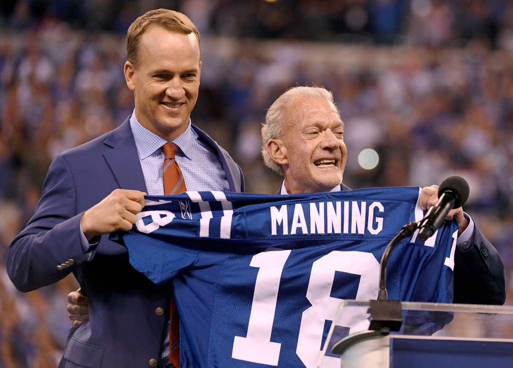 Peyton Manning and Jim Irsay, owner of the Indianapolis Colts, pose for photos during a ceremony retiring Manning's jersey on October 8, 2017 in Indianapolis, Indiana.