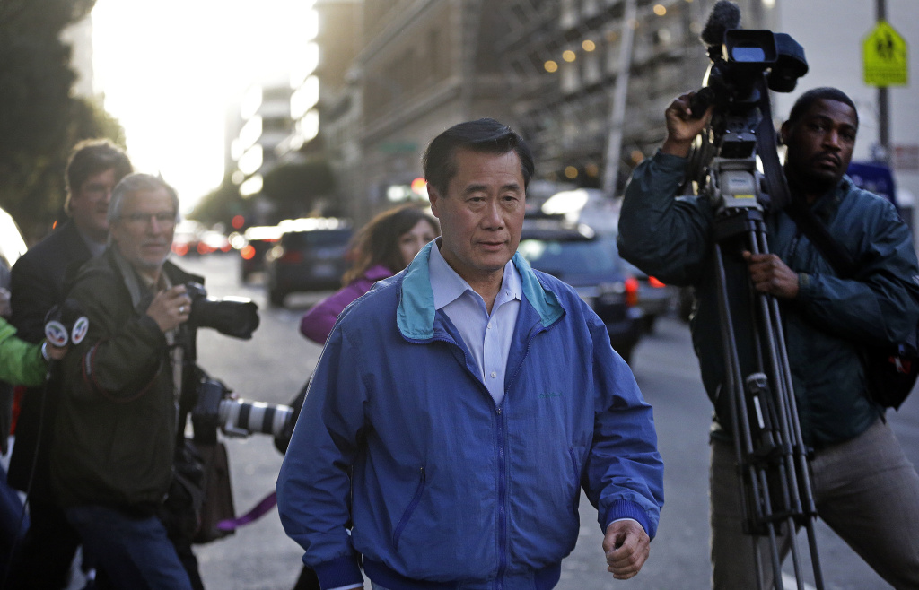 California Sen. Leland Yee, D-San Francisco, center, leaves the San Francisco Federal Building, Wednesday, March 26, 2014, in San Francisco. The FBI has filed a 137-page affidavit outlining a detailed corruption case against Yee, who is accused of asking for campaign donations in exchange for introducing an undercover agent to an arms trafficker.