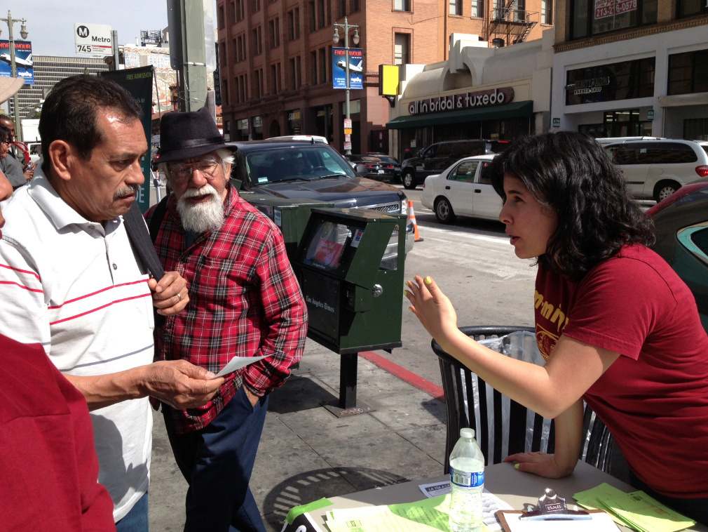 Charlene Gomez of the Coalition for Humane Immigrant Rights of Los Angeles asks passers-by on Broadway in downtown L.A. if they're willing to leave messages for a member of Congress during an immigration