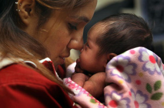 Janeth Fernandez holds her daughter Sarah during a newborn check-up on February 23, 2010 in Aurora, Colorado.
