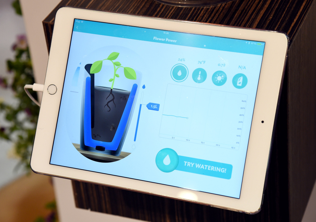 Information from the Parrot Pot by Parrot is displayed at the 2015 International CES at the Las Vegas Convention Center on January 8, 2015 in Las Vegas, Nevada. The connected pot's automatic watering system delivers the exact amount of water at the right time for plants and has four sensors to measure sunlight, soil moisture, temperature and fertilizer levels and comes with a free App that provides expert advice on more than 8,000 plants.
