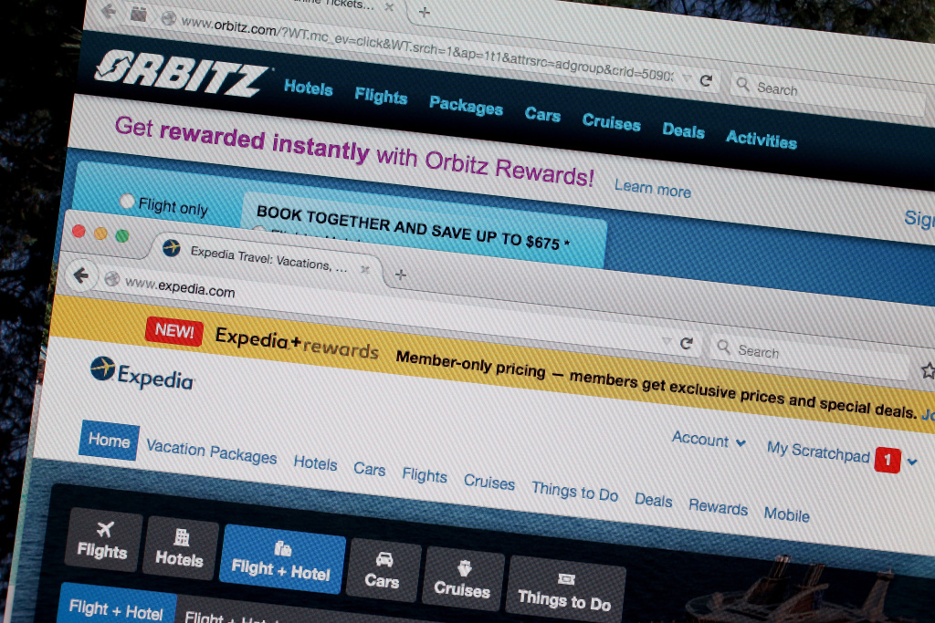In this photo illustration, the website for Expedia Inc. and Orbitz Worldwide Inc. are seen next to each other on February 12, 2015 in Miami, Florida.  Expedia annouced plans to purchase Orbitz for about 1.34 billiion dollars.
