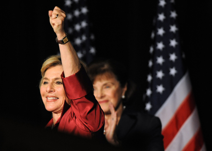 Senator Barbara Boxer (L) celebrates with Senator Dianne Feinstein (R) after winning a fourth term, in the Democratic Party headquarters at the Renaissance Hotel in Hollywood on November 3, 2010.     AFP PHOTO/Mark RALSTON (Photo credit should read MARK RALSTON/AFP/Getty Images)