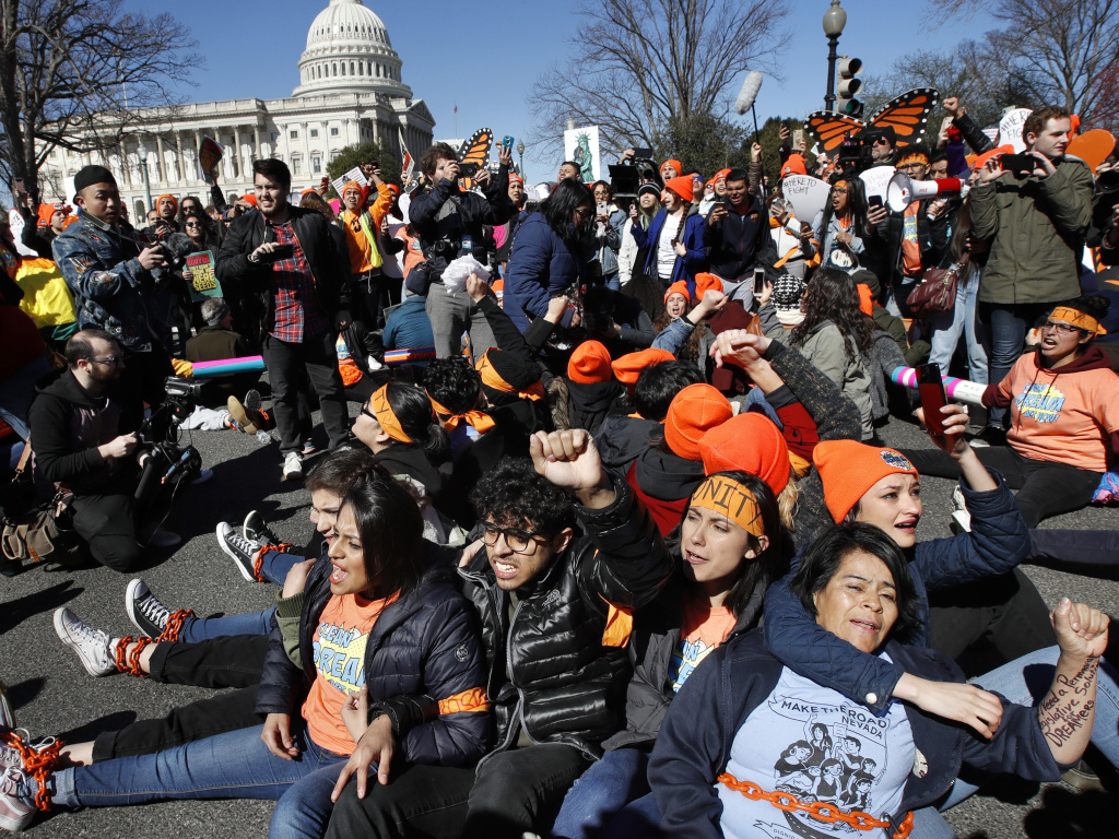 Supporters of the Deferred Action for Childhood Arrivals (DACA) program, participate in civil disobedience in March 2018 on Capitol Hill in Washington.