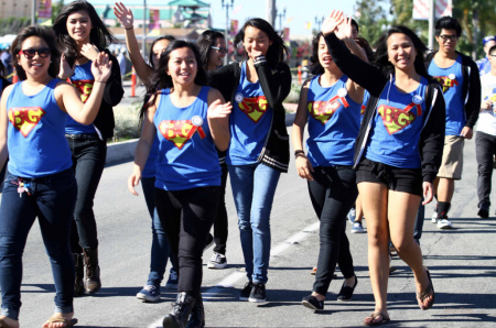 Women march in a Tet festival parade in Orange County. A new report shows Asian-Americans are Orange County's fastest-growing population. But as their numbers grow, so is the percentage of Asian Americans facing economic hardships.