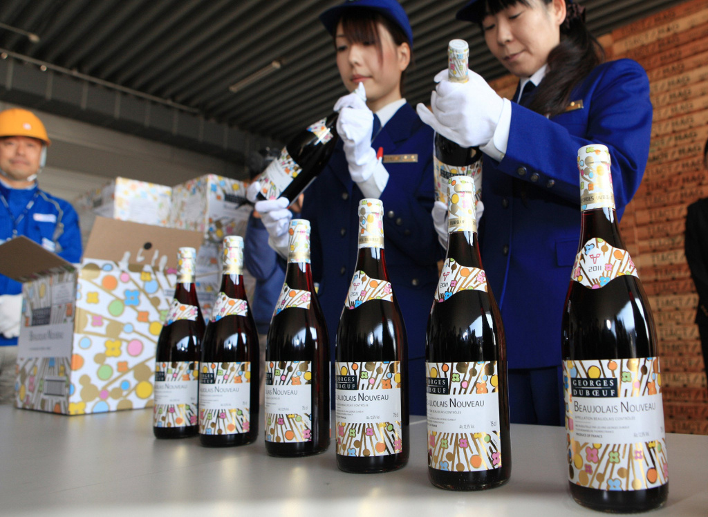 Japanese customs officers check bottles of 2011 Beaujolais Nouveau wine made in Bourgogne just after the arrival at Haneda Airport in Tokyo on Oct. 29, 2011. Beaujolais Nouveau is released at midnight the third week of November each year.