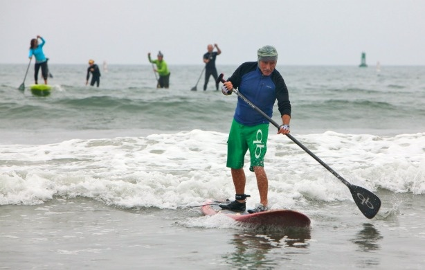 74 year-old surfing legend Mickey Munoz finishes the 2 mile Fun Paddle. Munoz, who grew up surfing and paddleboarding in Santa Monica was the oldest competitor in the event and finished 2nd in his division.