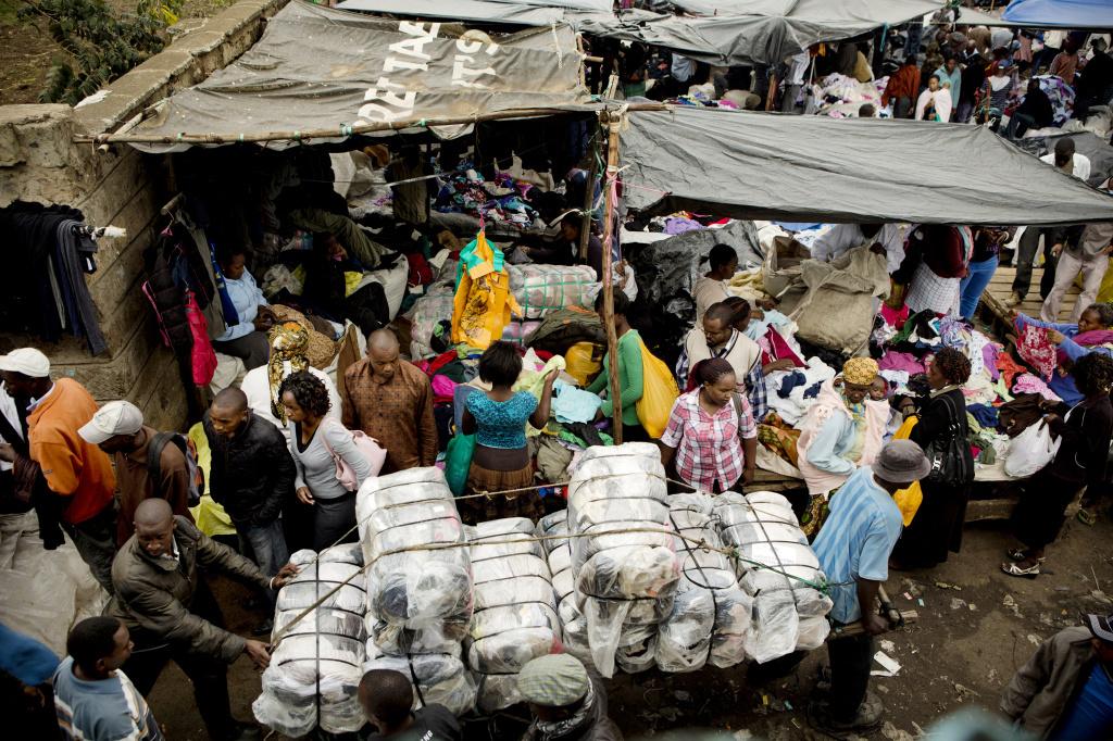 Bales of imported clothing are wheeled into the Gikombo Market in Nairobi, Kenya.