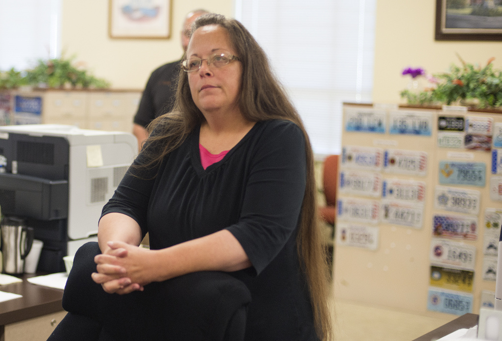 Kim Davis, the Rowan County Clerk of Courts, listens to Robbie Blankenship and Jesse Cruz as they speak with her at the County Clerks Office on September 2, 2015 in Morehead, Kentucky. Citing a sincere religious objection, Davis, an Apostolic Christian, has refused to issue marriage licenses to same sex couples in defiance of a Supreme Court ruling
