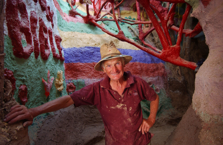 Leonard Knight enjoys the relatively cool temperature of one of his structures of straw bales and adobe near Salvation Mountain May 30, 2002 near Niland, CA, east of the Salton Sea.