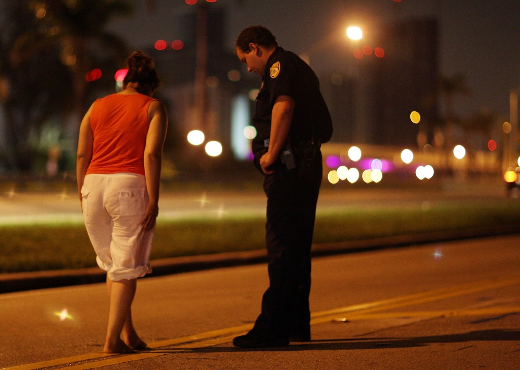City of Miami police officer E. Dominguez conducts a field sobriety test at a DUI traffic checkpoint June 4, 2007 in Miami, Florida.