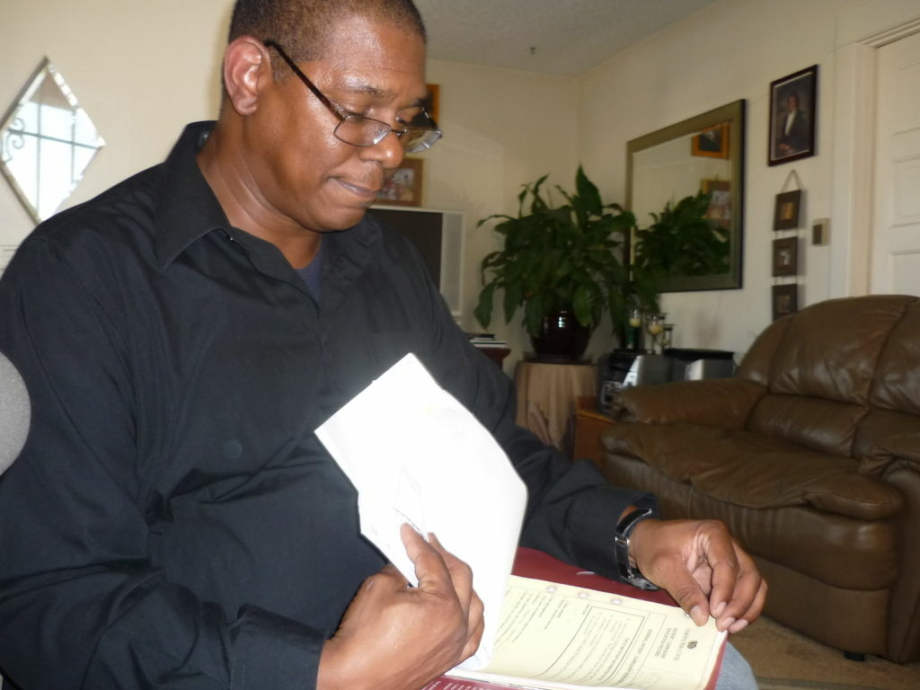 Larry Biggles looks through what he calls his 'care packet' from Cedars' Sinai Medical Center.  Emergency room nurses gave him the folder when they discharged him after his CT Scan in September, 2008.  He hopes hospitals officials will be as forthcoming now with radiation overdose information.