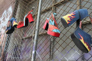 High-heel shoes hang from a gated window in an empty alley behind the National Lodge Motel. The Oakland city attorney has filed suit against the motel, arguing that it knowingly facilitates child sex trafficking.