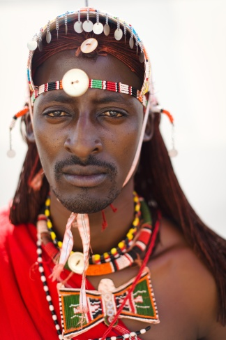Nissan Jonathan Meshami of the Maasai Warrior cricket team from Kenya prepares to take part in a friendly match against the Charity VIII team during opening ceremony activities of the