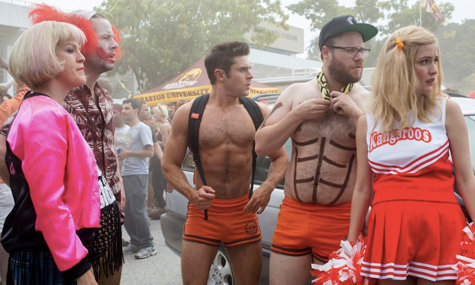 Original cast members Zac Efron (center), Seth Rogen (center right) and Rose Byrne (right) find a new challenge in