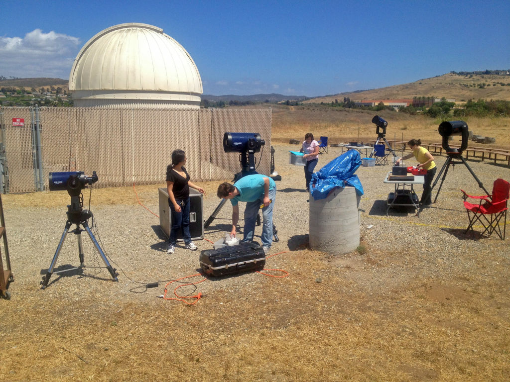 UCI students and UCI Observatory director and astronomy professor Tammy Smecker-Hane set up telescopes for the Transit of Venus.