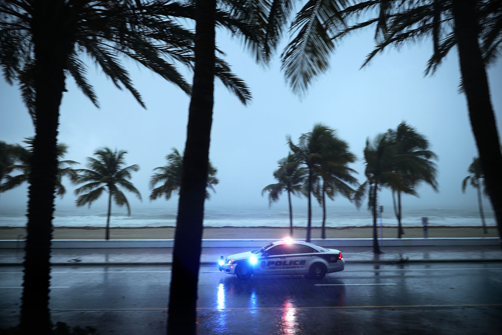 Police patrol the street running along Sebastian Street Beach in Fort Lauderdale, Florida ahead of the arrival of Hurricane Irma September 9, 2017.