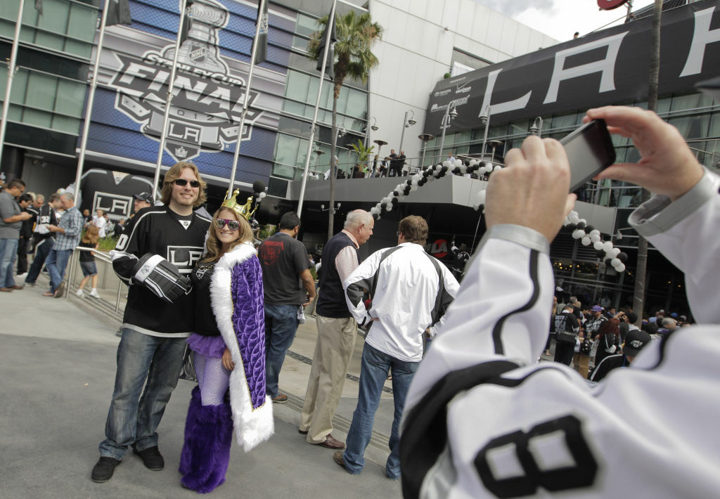 Los Angeles Kings fans Justin Bran, left, and Amelia Cline pose for a photo outside the Staples Center before Game 3 of the Stanley Cup Finals against the New Jersey Devils, Monday, June 4, 2012, in Los Angeles.