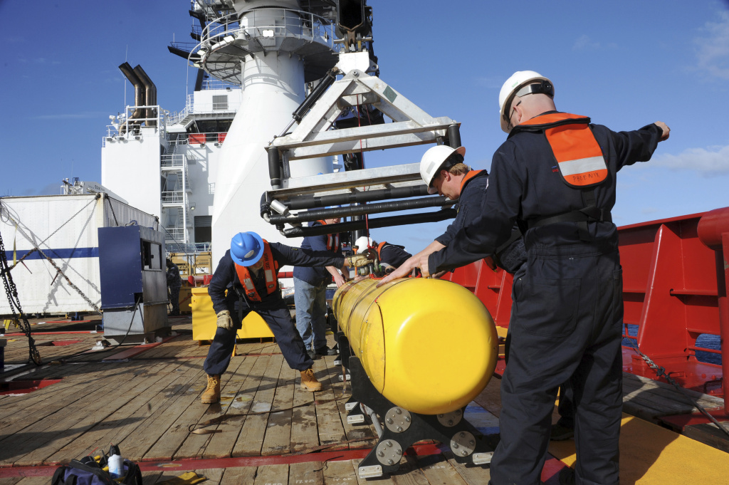 In this photo taken on Tuesday, April 1, 2014, provided by the U.S. Navy, the Bluefin 21, Artemis autonomous underwater vehicle (AUV) is hoisted back on board the Australian Defense Vessel Ocean Shield after successful buoyancy testing in the Indian Ocean, as search efforts continue for missing Malaysia Airlines Flight 370.