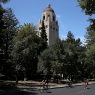 People ride bikes past Hoover Tower on the Stanford University campus on May 22, 2014 in Stanford, California.