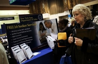People looking for jobs wait in line to speak with potential employers at the Brooklyn Job Fair on April 13, 2011 in the Brooklyn borough of New York City.