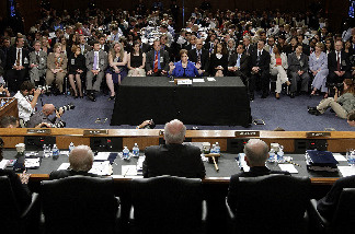 U.S. Supreme Court Justice nominee Elena Kagan gives her opening statement to the Senate Judiciary Committee Chairman on the first day of her confirmation hearings on Capitol Hill June 28, 2010 in Washington, DC.