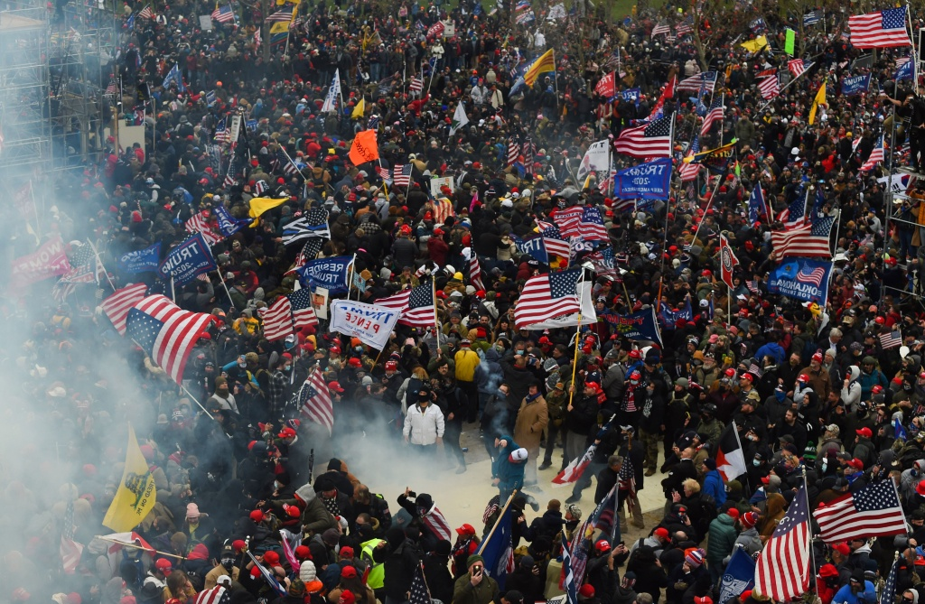 Trump supporters clash with police and security forces as they storm the US Capitol in Washington D.C on January 6, 2021. Demonstrators breeched security and entered the Capitol as Congress debated the a 2020 presidential election Electoral Vote Certification.