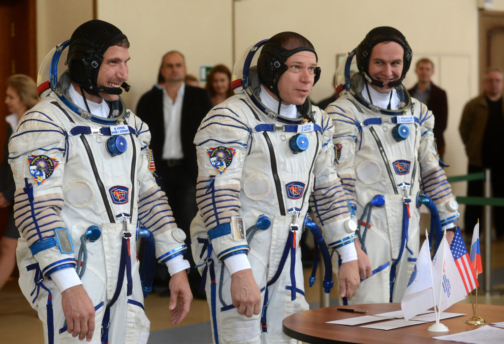 US astronaut Michael Hopkins (L) together with Russian cosmonauts, Oleg Kotov (C) and Sergey Ryazanskiy, prepare to answer questions during their final preflight exam at the Gagarin Cosmonauts' Training Centre in Star City centre outside Moscow on September 4, 2013.