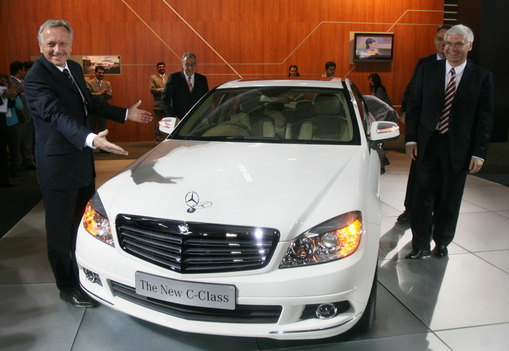 President and CEO of Mercedes-Benz Joachim Schmidt (L) and Managing Director and CEO, Daimler-Chrysler India, Wilfried Aulbur (R) pose with the Mercedes-Benz C-Class car during the launch at the 9th International Auto Expo in New Delhi, 09 January 2008.
