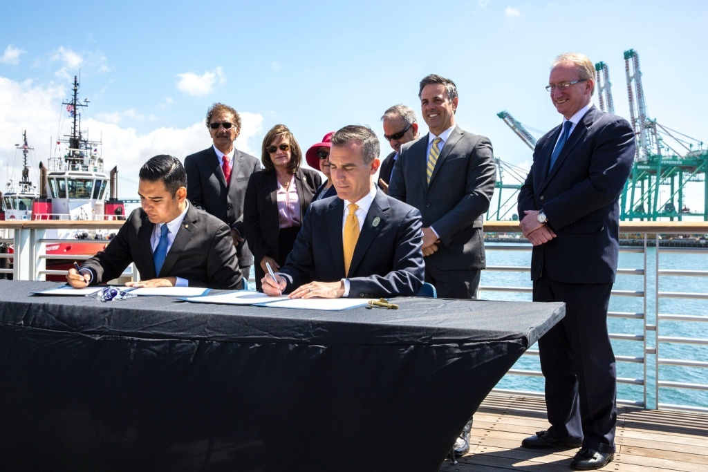 Los Angeles Mayor Eric Garcetti (right) and Long Beach Mayor Robert Garcia (left) sign a joint declaration on Monday, June 12, 2017, setting environmental goals for their respective ports and reaffirming their commitment to adopting the Paris climate agreement goals.