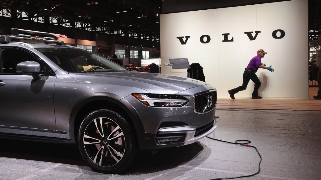 Workers prepare the Volvo display before the opening of the Chicago Auto Show on Feb. 6. Volvo said it will limit all of its new cars to a top speed of  about 112 mph, starting in 2020.
