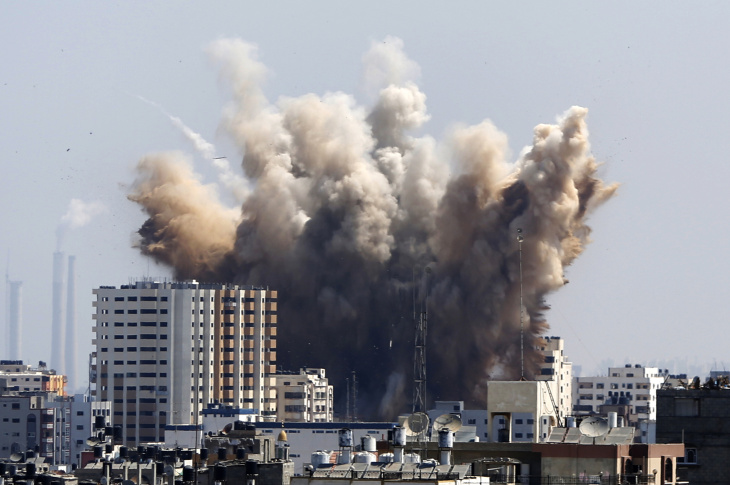 Smoke, dust and debris rise over Gaza City after an Israeli strike, Friday, Aug. 8, 2014, as Israel and Gaza militants resumed cross-border attacks after a three-day truce expired and Egyptian-brokered talks on a new border deal for blockaded Gaza hit a deadlock.
