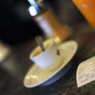 A till receipt is displayed on a bar on