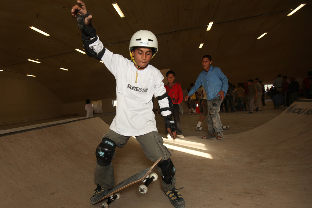 A young Afghan skateboarder enjoys a skatepark during a promotional event held by the 'Skateistan' NGO in Kabul on June 21, 2010. Skateistan aims to engage growing numbers of urban and internally-displaced youth in Afghanistan through skateboarding.