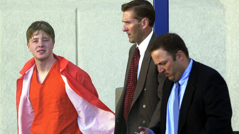 Lucas Helder is escorted by federal authorities from a county jail in Nevada.