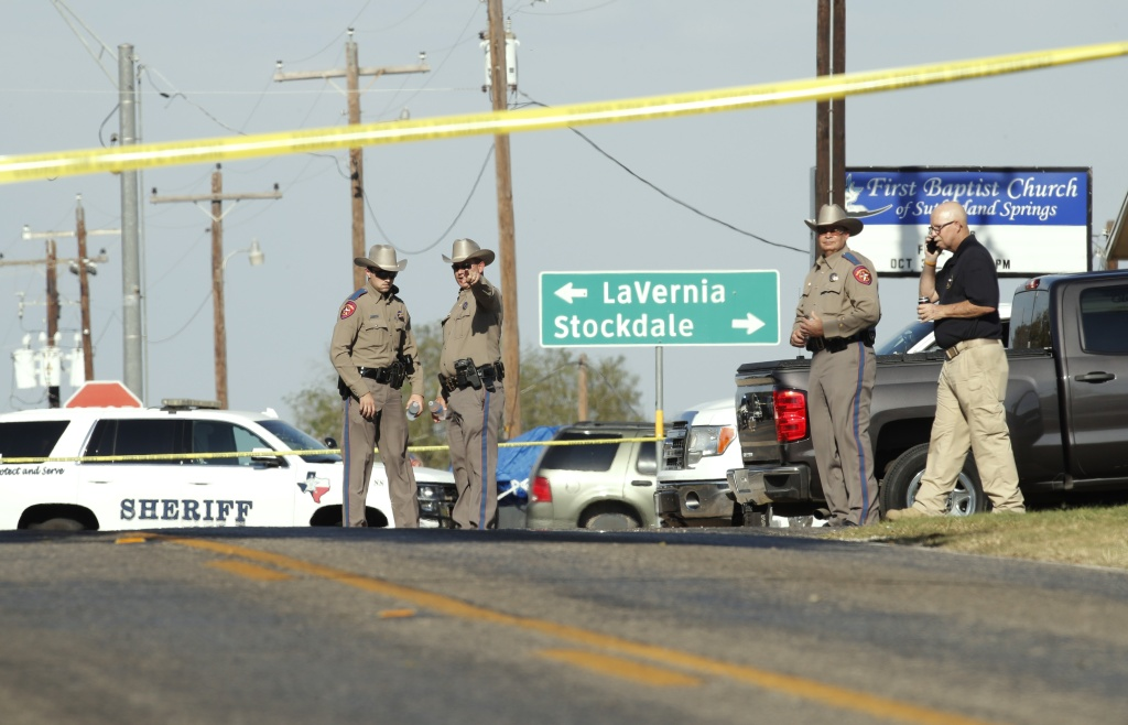 Law enforcement officials gather near First Baptist Church following a shooting on November 5, 2017 in Sutherland Springs, Texas.
