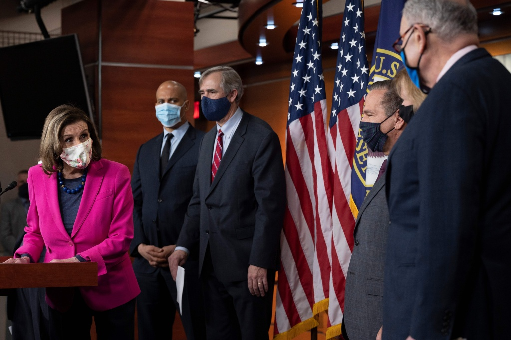 Speaker of the House Nancy Pelosi (L), and Senate Majority Leader Chuck Schumer (R) join Senate and House leaders for a news conference on Capitol Hill in Washington, DC, on February 25, 2021.