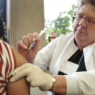 Widespread flu vaccination is intended to protect people who are at risk for serious complications from the virus.