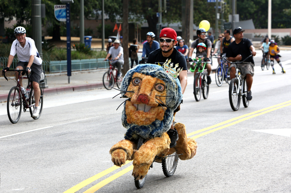 Angel Cruz from San Fernando Valley rides his bike along the streets of downtown Los Angeles on Oct. 18, 2015 as part of CicLAvia.