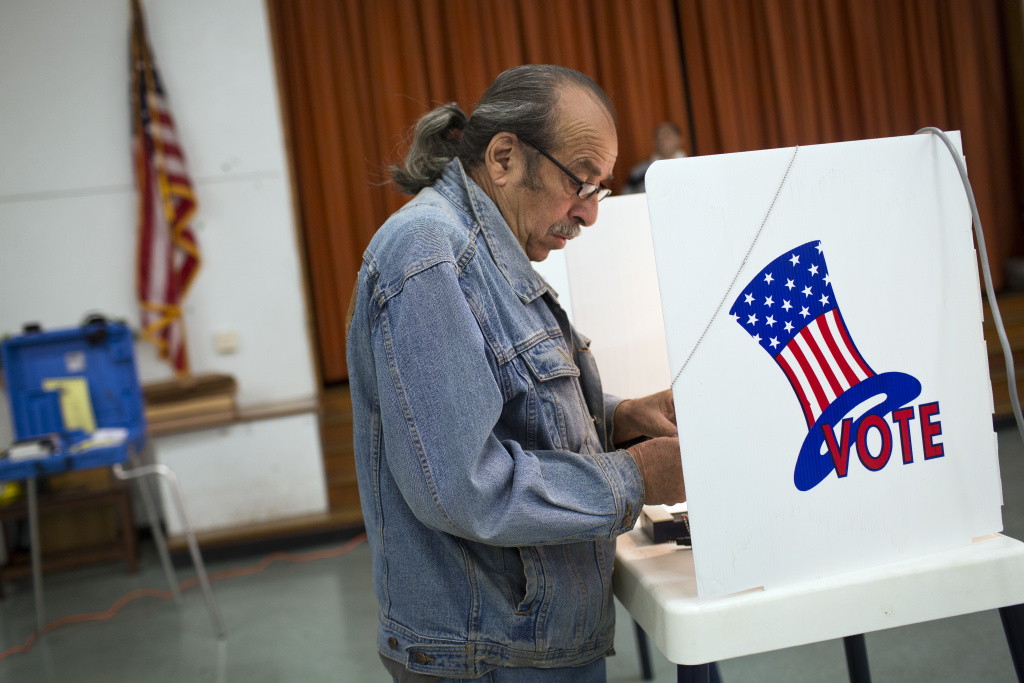 FIILE PHOTO: Antonio Torres of El Sereno votes on Election Day at El Sereno Elementary School in 2015.