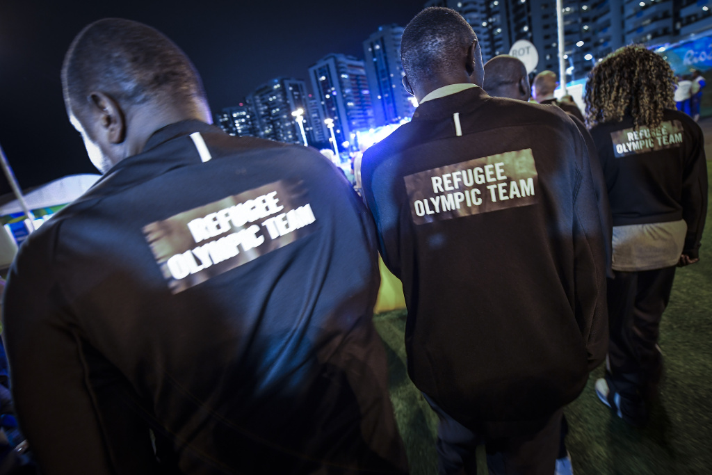 Refugee Olympic Team athletes for the Rio 2016 Olympic Games attend their welcome ceremony at the Athletes village on August 3, 2016 in Rio de Janeiro, Brazil.