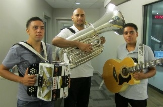 Los Hermanos Carrillo Con El Chikilin Y Su Tuba poses outside the studio