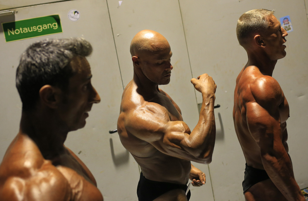 A competitor prepares backstage before competing in the Men's Classic Bodybuilding during the World Classic Bodybuilding Championship in St Polten on November 16, 2013.