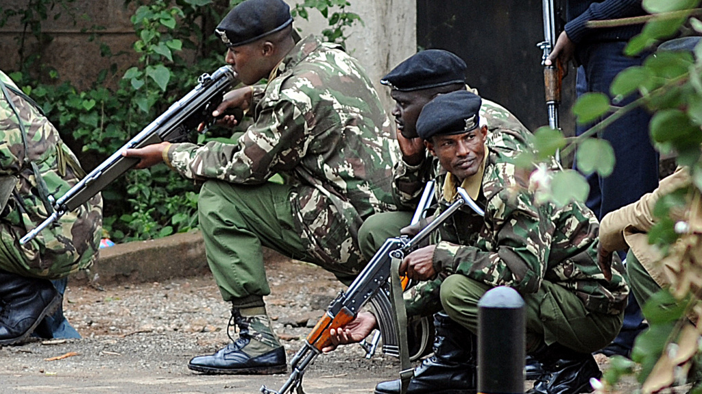 These Kenyan police officers were taking cover outside the Westgate mall in Nairobi on Monday.